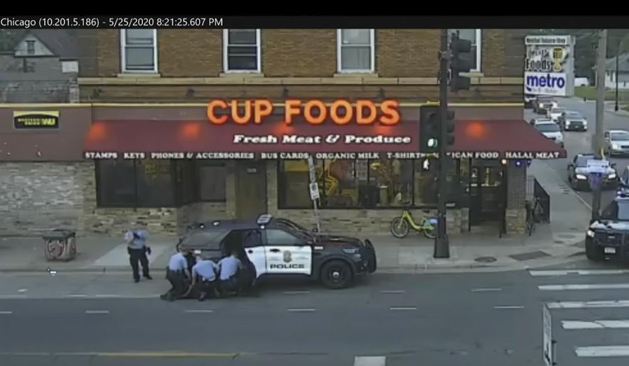 FILE - In this May 25, 2020 file image from Minneapolis city surveillance video, Minneapolis police are seen attempting to take George Floyd into custody in Minneapolis, Minn. The video was shown as Hennepin County Judge PeterCahill presided on Monday, March 29, 2021, in the trial of former Minneapolis police officer Derek Chauvin, in the death of Floyd at the Hennepin County Courthouse in Minneapolis, Minn. (Court TV via AP, Pool, File)