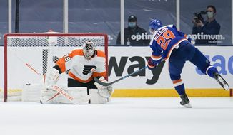 New York Islanders' Brock Nelson (29) shoots the puck past Philadelphia Flyers goaltender Carter Hart (79) for the game winning goal during the shootout period of an NHL hockey game Thursday, April 8, 2021, in Uniondale, N.Y. The Islanders won 3-2. (AP Photo/Frank Franklin II)