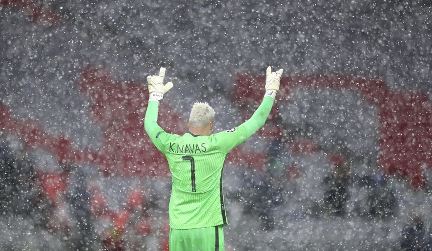 PSG's goalkeeper Keylor Navas reacts after the Champions League quarterfinal soccer match between Bayern Munich and Paris Saint Germain in Munich, Germany, Wednesday, April 7, 2021. PSG won 3-2. (AP Photo/Matthias Schrader)