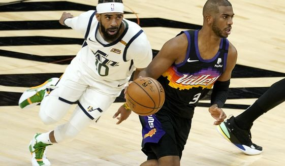 Phoenix Suns guard Chris Paul (3) drives as Utah Jazz guard Mike Conley (10) pursues during the first half of an NBA basketball game, Wednesday, April 7, 2021, in Phoenix. (AP Photo/Matt York)