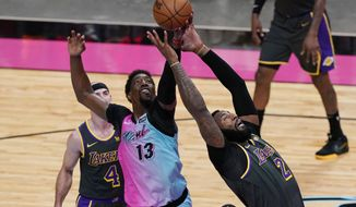 Miami Heat center Bam Adebayo (13) and Los Angeles Lakers center Andre Drummond (2) go after a rebound during the second half of an NBA basketball game, Thursday, April 8, 2021, in Miami. (AP Photo/Marta Lavandier)