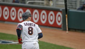 Minnesota Twins' Mitch Garver flips his bat after hitting a three run home run against the Seattle Mariners in the third inning of a baseball game Thursday, April 8, 2021, in Minneapolis. (AP Photo/Bruce Kluckhohn)