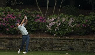Justin Rose, of England, tees off on the 12th hole during the first round of the Masters golf tournament on Thursday, April 8, 2021, in Augusta, Ga. (AP Photo/Charlie Riedel)