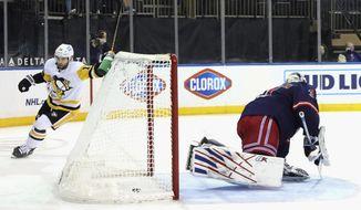 Pittsburgh Penguins' Jason Zucker (16) scores a goal against New York Rangers' Igor Shesterkin (31) during the third period of an NHL hockey game Thursday, April 8, 2021, in New York. (Bruce Bennett/Pool Photo via AP)