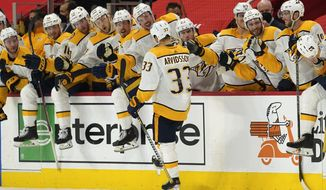 Nashville Predators right wing Viktor Arvidsson (33) celebrates scoring on a penalty shot against the Detroit Red Wings in the third period of an NHL hockey game Thursday, April 8, 2021, in Detroit. (AP Photo/Paul Sancya)