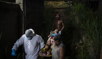Mobile Emergency Care Service (SAMU) worker Sergio Ricardo, left, and two neighbors, carry an elderly COVID-19 patient to an ambulance in Duque de Caxias, Rio de Janeiro state, Brazil, Wednesday, April 7, 2021. (AP Photo/Felipe Dana)