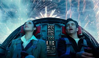 """Wonder Woman (Gal Gadot) with Steve Trevor (Chris Pine) piloting the invisible jet in one of the more visual stunning examples of ultra-high definition in """"Wonder Woman 1984,"""" now available in the 4K Ultra HD format from Warner Bros. Home Entertainment."""