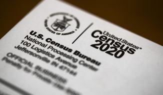 FILE - This March 19, 2020, file photo, shows an envelope containing a 2020 census letter mailed to a U.S. resident. On Wednesday, March 24, 2021, a federal judge dismissed a lawsuit filed by the state of Ohio that tried to get the U.S. Census Bureau to provide data used for drawing congressional and legislative districts ahead of its planned release. (AP Photo/Matt Rourke, File)