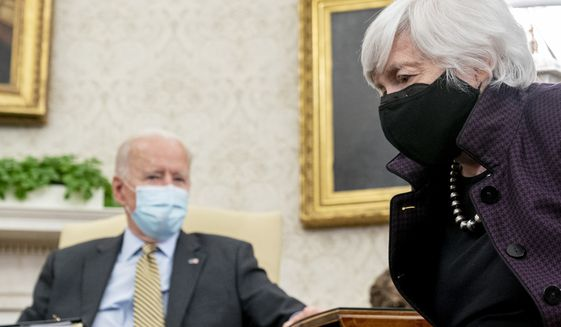 President Joe Biden, accompanied by Treasury Secretary Janet Yellen, right, speaks as he gets his weekly economic briefing in the Oval Office of the White House, Friday, April 9, 2021, in Washington. (AP Photo/Andrew Harnik) **FILE**