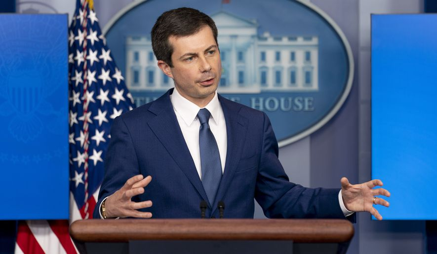 Transportation Secretary Pete Buttigieg speaks at a press briefing at the White House, Friday, April 9, 2021, in Washington. (AP Photo/Andrew Harnik)