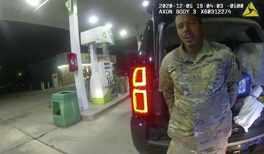 In this image made from Windsor, (Va.) Police video, a police officer speaks with Caron Nazario during a traffic stop on Dec. 20, 2020, in Windsor, Va. Nazario, a second lieutenant in the U.S. Army, is suing two Virginia police officers over a traffic stop during which he says the officers drew their guns and pointed them at him as he was dressed in uniform. Caron Nazario says his constitutional rights were violated by the traffic stop in the town of Windsor in December. (Windsor Police via AP).