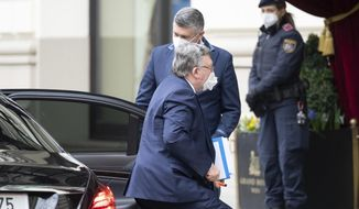 Russia's Governor to the International Atomic Energy Agency (IAEA), Mikhail Ulyanov, arrives at the Grand Hotel Wien where closed-door nuclear talks with Iran take place in Vienna, Austria, Tuesday, April 6, 2021. Foreign ministry officials from the countries still in the accord, the so-called Joint Comprehensive Plan of Action, are meeting in Vienna to push forward efforts to bring the United States back into the 2015 deal on Iran's nuclear program. (AP Photo/Florian Schroetter)