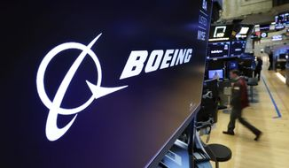 FILE - In this March 11, 2019 file photo, the Boeing logo appears above a trading post on the floor of the New York Stock Exchange before the opening bell.  Boeing is suing a subcontractor it hired to work on new Air Force One planes that will carry the president of the United States. Boeing says a subcontractor on in Fort Worth, Texas, missed deadlines for work on the planes.  (AP Photo/Richard Drew, File)