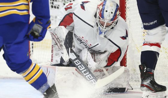 Washington Capitals goalie Vitek Vanecek (41) makes a save during the first period of an NHL hockey game against the Buffalo Sabres, Friday, April 9, 2021, in Buffalo, N.Y. (AP Photo/Jeffrey T. Barnes)