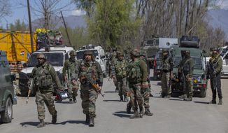 Indian army soldiers leave the site of a gunbattle in Pulwama, south of Srinagar, Indian controlled Kashmir, Friday, April 2, 2021. Anti-India protests and clashes have erupted between government forces and locals who thronged a village in disputed Kashmir following a gunbattle that killed three suspected militants. Police say the gunfight on Friday erupted shortly after scores of counterinsurgency police and soldiers launched an operation based on tip about presence of militants in a village in southern Pulwama district. (AP Photo/ Dar Yasin)