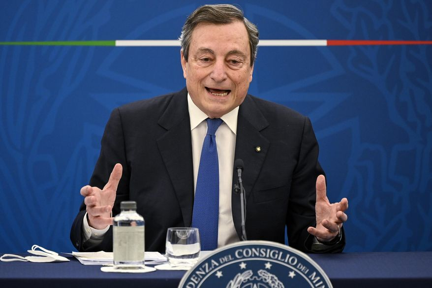 """FILE -- In this April 8, 2021 file photo Italian Premier Mario Draghi speaks during a press conference in Rome .  Turkey demanded Friday that Italy's premier apologize for having called President Tayyip Erdogan a """"dictator,"""" adding fuel to the scandal over the perceived seating snub of the European Commission president and deepening the EU-Turkey rift at the precise moment both sides were hoping for rapprochement.  (Riccardo Antimiani/Pool Photo via AP)"""