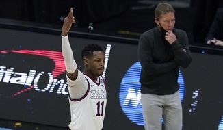 Gonzaga guard Joel Ayayi (11) celebrates after making a 3-point basket during the first half of a men's Final Four NCAA college basketball tournament semifinal game against UCLA, Saturday, April 3, 2021, at Lucas Oil Stadium in Indianapolis. (AP Photo/Darron Cummings)