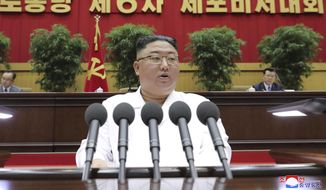 In this photo provided by the North Korean government, North Korean leader Kim Jong-un delivers a closing speech at the Sixth Conference of Cell Secretaries of the Workers' Party of Korea in Pyongyang, North Korea, Thursday, April 8, 2021. (Korean Central News Agency/Korea News Service via AP)