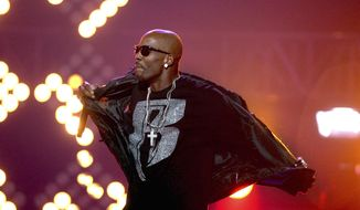 """DMX performs during the BET Hip Hop Awards in Atlanta on Oct. 1, 2011. The family of rapper DMX says he has died at age 50 after a career in which he delivered iconic hip-hop songs such as """"Ruff Ryders' Anthem."""" (AP Photo/David Goldman, File)"""