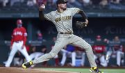 San Diego Padres starting pitcher Joe Musgrove (44) delivers a pitch to a Texas Rangers batter during the first inning of a baseball game Friday, April 9, 2021, in Arlington, Texas. (AP Photo/Richard W. Rodriguez)