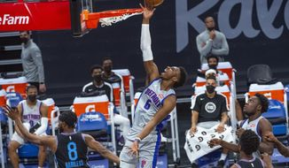Detroit Pistons guard Hamidou Diallo (6) lays the ball up against the Sacramento Kings during the first quarter of an NBA basketball game in Sacramento, Calif., Thursday, April 8, 2021. (AP Photo/Randall Benton)