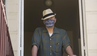Nathan Long, a video game writer, poses for a picture inside his rental apartment in Glendale, Calif., Thursday, April 8, 2021. He and his wife, Lili, have been unsuccessful so far in their search for a home in Los Angeles. (AP Photo/Damian Dovarganes)