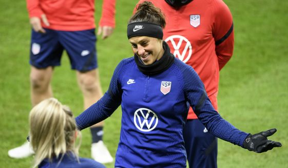 Carli Lloyd of the US and her teammates train at Friends arena in Stockholm, Sweden, Friday April 9, 2021, ahead of the friendly international soccer match against Sweden on Saturday. (Henrik Montgomery/TT News Agency via AP)