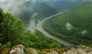FILE - This May 9, 2012, file photo, shows the Grandview State Park overlooking the New River Gorge National River in Grandview, W.Va. The state offers numerous trails for hiking and other spots with scenic views. With West Virginia poised to lose another congressional seat due to its long, steady population decline, Republican lawmakers are convinced a massive tax cut is the key to reversing the trend. (Kenny Kemp/Charleston Gazette-Mail via AP, File)