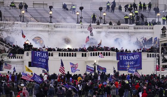 In this Wednesday, Jan. 6, 2021, file photo, violent rioters storm the Capitol, in Washington. (AP Photo/John Minchillo, File)