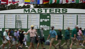 Spectators leave the course after a weather warning was issued and play stopped during the third round of the Masters golf tournament on Saturday, April 10, 2021, in Augusta, Ga. (AP Photo/Matt Slocum)