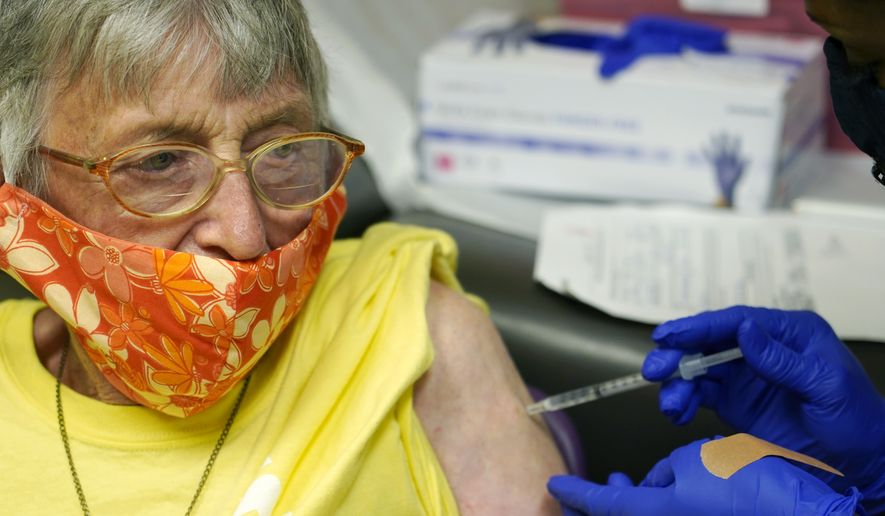 An elderly woman is shown here receiving the Johnson & Johnson COVID-19 vaccine at a community health center Wednesday, April 7, 2021, in Clarksdale, Miss. Starting Monday, April 19, the District of Columbia will open ten walk-up vaccination sites throughout the city for residents aged 65 and up. (AP Photo/Rogelio V. Solis)  **FILE**