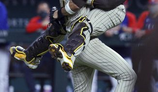 San Diego Padres starting pitcher Joe Musgrove (44) and catcher Victor Caratini (17) celebrate Musgrove's no-hitter against the Texas Rangers in a baseball game Friday, April 9, 2021, in Arlington, Texas. (AP Photo/Richard W. Rodriguez)
