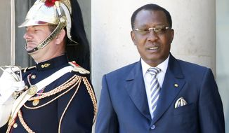 FILE - In this May 17, 2014 file photo, Chadian President Idriss Deby Itno leave the Elysee Palace in Paris. Deby is seeking to extend his three-decade long rule, running for a sixth time in this oil-producing Central African nation that is home to nearly half a million refugees and also plays a prominent role in the fight against Islamic extremism in the Sahel. (AP Photo/Francois Mori, file)