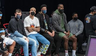 Los Angeles Lakers center Marc Gasol, forward Kyle Kuzma, forward Anthony Davis and forward LeBron James sit on the bench during the first half of the team's NBA basketball game against the Brooklyn Nets, Saturday, April 10, 2021, in New York (AP Photo/Corey Sipkin). **FILE**