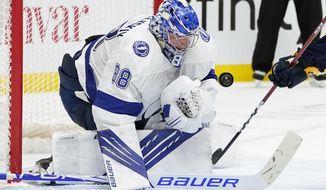 Tampa Bay Lightning goaltender Andrei Vasilevskiy blocks a shot against the Nashville Predators in the second period of an NHL hockey game Saturday, April 10, 2021, in Nashville, Tenn. (AP Photo/Mark Humphrey)