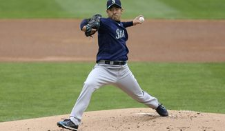 Seattle Mariners pitcher Yusei Kikuchi (18) throws against the Minnesota Twins during the first inning of a baseball game, Saturday, April 10, 2021, in Minneapolis. (AP Photo/Stacy Bengs)