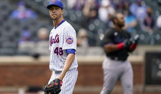 New York Mets starting pitcher Jacob deGrom (48) walks off the field after striking out Miami Marlins' Jesus Aguilar in the first inning of a baseball game, Saturday, April 10, 2021, in New York. (AP Photo/John Minchillo)