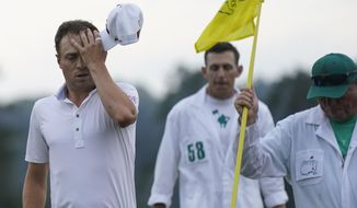 Justin Thomas wipes his forehead after finishing on the 18th hole during the third round of the Masters golf tournament on Saturday, April 10, 2021, in Augusta, Ga. (AP Photo/David J. Phillip)