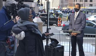 This image released by MSNBC shows Correspondent Shaquille Brewster, right, on location covering the the trial of former Minneapolis police officer Derek Chauvin in Minneapolis, Minn., on Wednesday April 7, 2021. Chauvin is charged with murder in the death of George Floyd during an arrest last May in Minneapolis. (MSNBC via AP)