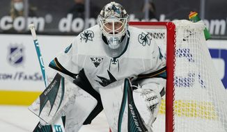 FILE - In this March 15, 2021, file photo, San Jose Sharks goaltender Devan Dubnyk (40) guards the net during an NHL hockey game against the Vegas Golden Knights in Las Vegas. The Colorado Avalanche acquired goaltender Devan Dubynk from the San Jose Sharks on Saturday, April 10, 2021, in exchange for defenseman Greg Pateryn and a fifth-round pick in the 2021 draft.  (AP Photo/John Locher, File)