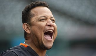 Detroit Tigers' Miguel Cabrera clowns around before a baseball game against the Cleveland Indians in Cleveland, Saturday, April 10, 2021. (AP Photo/Phil Long)