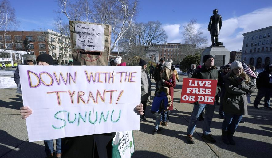 FILE - In this Thursday, Jan. 7, 2021 file photo, people protest outside the Statehouse in Concord, N.H., as Gov. Chris Sununu is inaugurated at noon for his third term as governor. A measure that recently passed New Hampshire's Republican-led House would prohibit governors from indefinitely renewing emergency declarations, as Sununu has done every 21 days for the past year. It would halt emergency orders after 30 days unless renewed by lawmakers. (AP Photo/Charles Krupa)