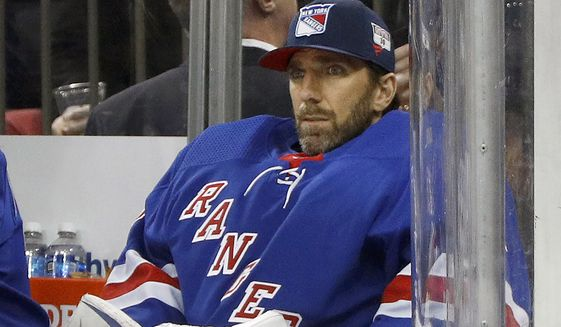 FILE - Then-New York Rangers goaltender Henrik Lundqvist looks on from the bench during an NHL hockey game against the Buffalo Sabres in New York, in this Friday, Feb. 7, 2020, file photo. Henrik Lundqvist is abandoning a long-shot attempt to return from open-heart surgery in time to play for the Washington Capitals this season after a checkup last week showed some inflammation. Lundqvist tweeted Sunday, April 11, 2021, that the inflammation around his heart requires a few months of rest and recovery. The 39-year-old goaltender had set the goal for himself of trying to join the Capitals before the end of the season. (AP Photo/Jim McIsaac, File)