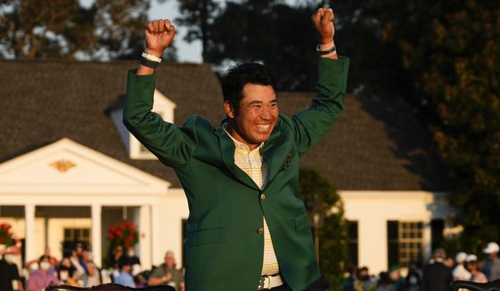 Hideki Matsuyama, of Japan, celebrates during champion's green jacket ceremony after winning the Masters golf tournament on Sunday, April 11, 2021, in Augusta, Ga. (AP Photo/David J. Phillip)
