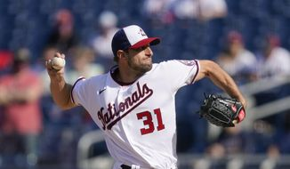 Washington Nationals starting pitcher Max Scherzer throws to the Atlanta Braves in the first inning of an opening day baseball game at Nationals Park, Tuesday, April 6, 2021, in Washington. (AP Photo/Alex Brandon)