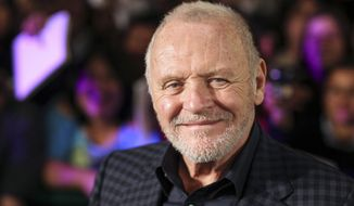 """FILE - In this Feb. 15, 2011 file photo, Anthony Hopkins smiles while posing for photos prior to the premiere of his new film """"The Rite"""" in Mexico City.  """"Nomadland"""" has won four prizes, including best picture, at the British Academy Film Awards on Sunday, April 11, 2021. The film's director, Chloe Zhao, became only the second woman to win the best director trophy, and star Frances McDormand was named best actress. """"Nomadland"""" also took the cinematography prize on Sunday. Emerald Fennell's revenge comedy """"Promising Young Woman"""" was named best British film, while the best actor trophy went to 83-year-old Anthony Hopkins for playing a man grappling with dementia in """"The Father."""" An event that was criticized in the recent past with the label #BAFTAsSoWhite rewarded a diverse group of talents, during a pandemic-curbed ceremony at London's Royal Albert Hall. (AP Photo/Alexandre Meneghini, File)"""