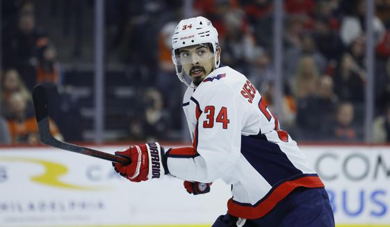 FILE - Washington Capitals' Jonas Siegenthaler plays during an NHL hockey game against the Philadelphia Flyers in Philadelphia, in this Wednesday, Jan. 8, 2020, file photo. The New Jersey Devils acquired defenseman Jonas Siegenthaler on Sunday, April 11, 2021, from the Washington Capitals for a 2021 third-round pick.  (AP Photo/Matt Slocum, File)