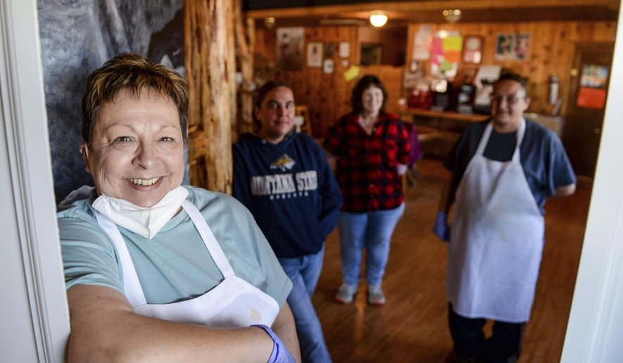 Ann Magee, left, manages the Junction Cafe in Browning, Mont. She says that business has been good since the tribal council's decision to reopen the reservation. She says that despite the reopening, ownership and employees are still in favor of take-out service only for the time being. (Rion Sanders/The Great Falls Tribune via AP)