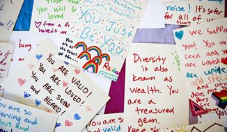 """Notes of Love"" are displayed on a table at Kalico Art Center in support of the LGBTQ+ community hosted by the Glacier Queer Alliance in Kalsipell, Mont., on March 31, 2021. (Hunter D'Antuono/Flathead Beacon via AP)"
