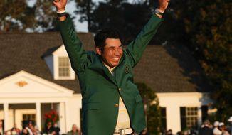 Hideki Matsuyama, of Japan, celebrates during champion's green jacket ceremony after winning the Masters golf tournament on Sunday, April 11, 2021, in Augusta, Ga. (AP Photo/David J. Phillip)